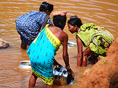 3 Women washing by the river